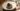 Ett egg konservert i aske med saus av tørket ørret og syltet ringblomst